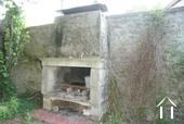 Maison de caractère du 19e & dépendances Ref # RT4997P image 20 Stone fireplace/grill in courtyard