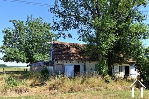 Petite maison avec jardin à rénover Ref # JP5035B