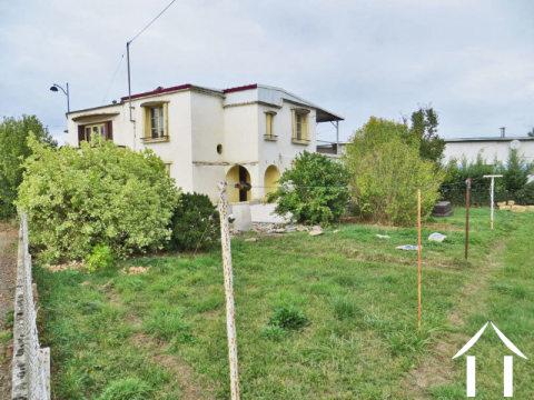 Maison de village aménagée en 2 appts sur terrain de 1250m2 Ref # MP9075